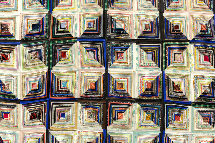 handmade classic Amish abstract geometric patchwork quilt texture background